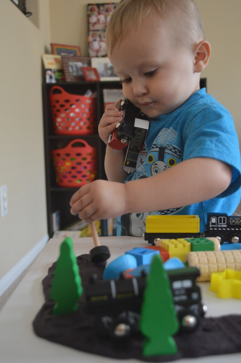 Making train tracks out of play dough